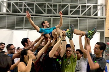 A man lifted up by several people at a team building event